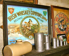 'The Irish Whiskey Company' and 'Player's Navy Cut' Signs, Pewter Jugs and Pottery Hot Water Bottle